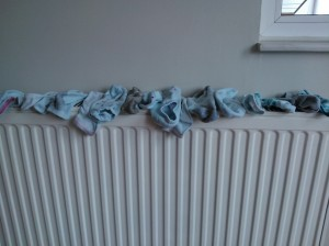 These are my friends socks drying on the heater. We don't have dryers, so in the cold weather, it can take a while for things to hang dry. This speeds up the process.